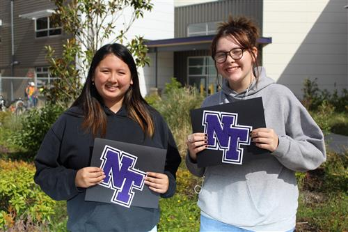 Two North Thurston students holding their letters.