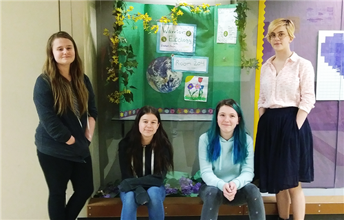 Members of the Warrior Ecology Club outside of their display in the Chinook hallway.