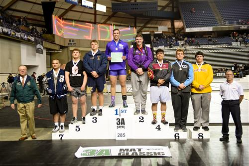 Wrestling podium after Mat Classic with North Thurston's Wrestler in 1st Place.