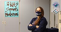 Stephanie O'Dell standing with a mask on in her classroom.