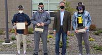 North Thurston HS students holding their award certificates, wearing masks