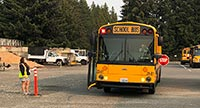 A bus with the stop sign deployed at a grading station held in the district's bus lot.