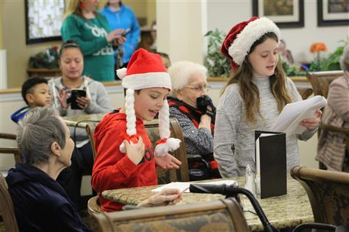 students singing with retirees