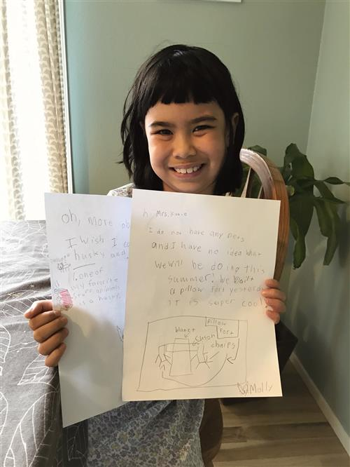student with letter for her pen pal