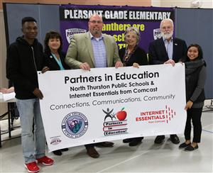 NTPS & Comcast hold the banner for their PIE Partnership