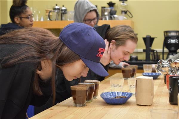 Students smell different coffees that were roasted.