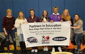 Old Navy and River Ridge hold their PIE Partnership Banner